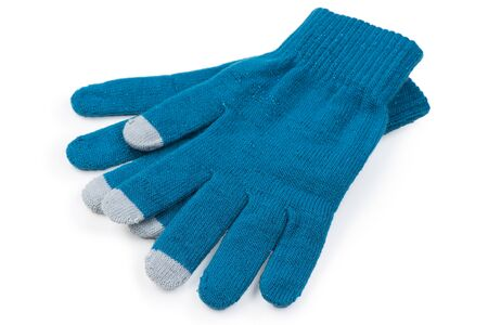 Photo pour warm clothes on a white background knitted gloves on a white background is insulated - image libre de droit