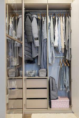 Photo pour Wardrobe with perfect order clothes shades - image libre de droit