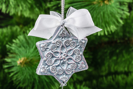 Beautiful toy of hand-worked for festive decoration, on a Christmas tree background