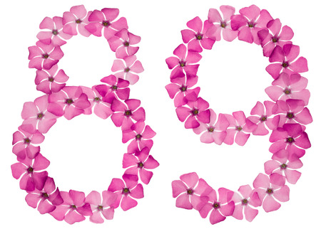 Numeral 89, eighty nine, from natural pink flowers of periwinkle, isolated on white background
