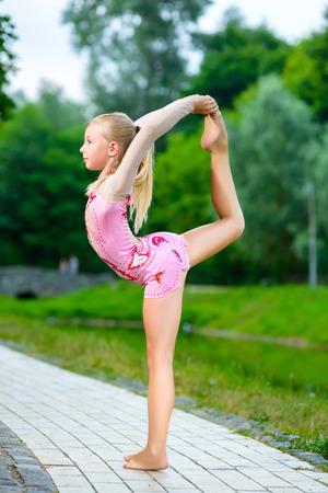 Image of flexible little girl doing gymnastics vertical split ...