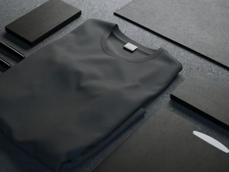 Foto de Dark mockup with blank t-shirt and business cards - Imagen libre de derechos
