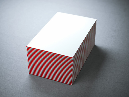 Photo pour Stack of white business cards with red edges in gray studio - image libre de droit