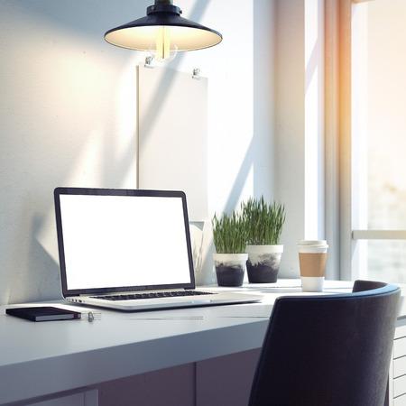 Foto de Workspace with silver modern laptop on the desk. 3d rendering - Imagen libre de derechos
