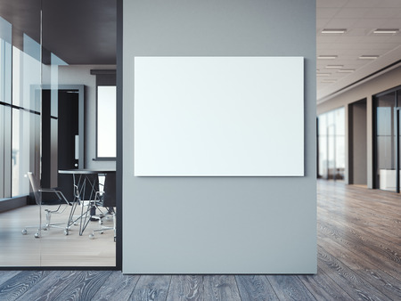 Foto de Empty white canvas on the modern office gray wall. 3d rendering - Imagen libre de derechos