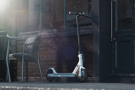 Electric scooter on cityscape background. eco transport concept. 3d rendering