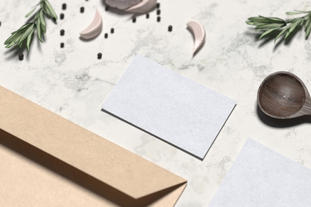 Photo pour Blank envelope and business card near wooden spoon and flavorings. Blank business stationery mock-up, template for branding identity on marble table. 3D rendering. - image libre de droit