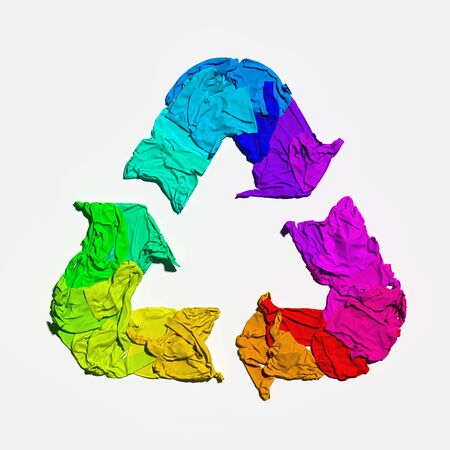 Foto de Multicolored recycling sign made from cloth on white background. Eco environment protection concept. 3d rendering. - Imagen libre de derechos