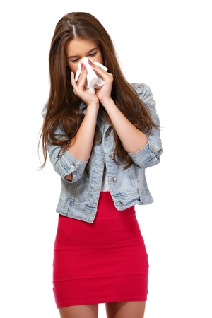 young woman has allergy and blowing her nose