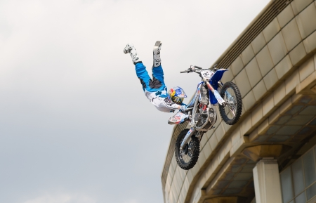 """RUSSIA, MOSCOW-JULY 13: Leading motofristayler Russia Alexey Kolesnikov at the sports festival """"Moscow City Games 2013"""" in the program Moto Freestyle (FMX) in Moscow, Arena """"Luzhniki"""" on July 13, 2013"""