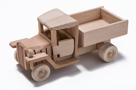 Wooden model of retro freight car on a white background.