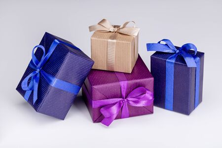 Photo for Gifts in multi-colored festive packaging, with ribbons and bows. White background, copy space. - Royalty Free Image