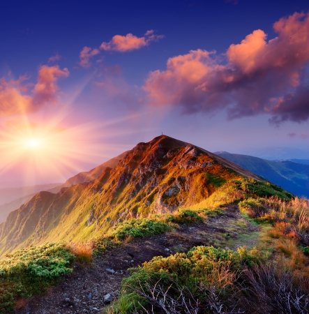 Photo for Beautiful summer sunrise in mountains  Path along the ridge leading to summit - Royalty Free Image
