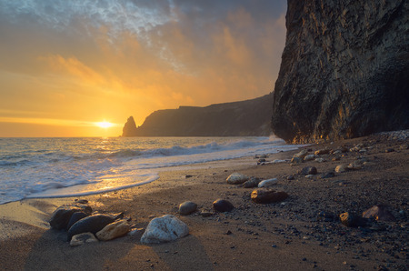 Seascape with sunset. Evening by the sea. Beautiful rock on the shore. Crimea
