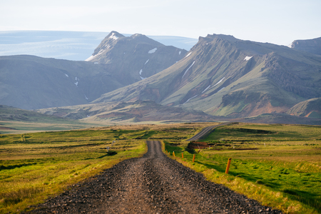 Road in Iceland. Summer landscape with beautiful view of the highlands. Exploring the beauty of world