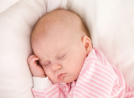 Photo pour sleeping baby in striped toddlers close up - image libre de droit