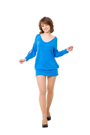 charming girl in a blue short dress. It is isolated on a white background