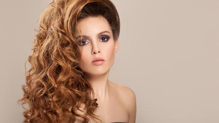 Foto de Portrait of a pretty woman with long hair and make-up. - Imagen libre de derechos