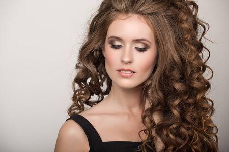 Foto de Beautiful woman with curly brown thick hair. Face closeup portrait - Imagen libre de derechos