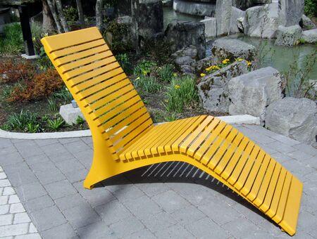 Photo pour Yellow modern metal outdoor patio chair - image libre de droit