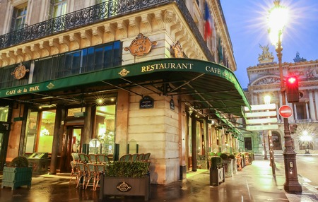 Paris, France-May 08, 2017: The famous cafe de la Paix located near opera house -Garnier palace in Paris, France. It had been inaugurated on May 5th , 1862.