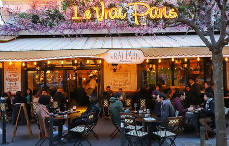 Photo for The famous Cafe Le Vrai Paris at night . It is located in the Montmartre, Paris, France. - Royalty Free Image