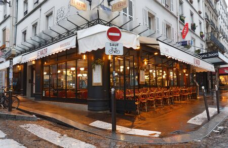 Le Nazir at rainy morning . It is a traditional French restaurant in the Montmartre district, Paris, France.