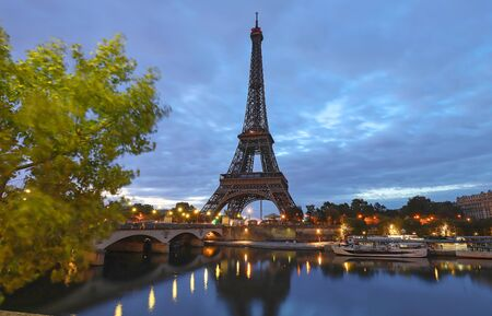Photo pour The Eiffel tower is the most popular travel place and global cultural icon of the France and the world. - image libre de droit