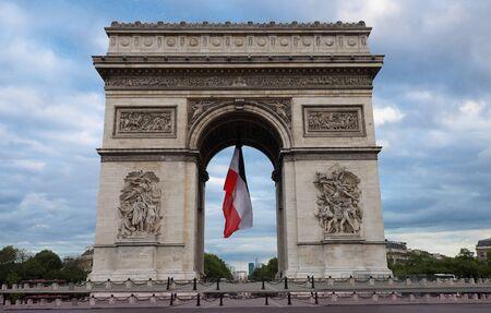Photo pour The Triumphal Arch decorated with French flag, Paris, France - image libre de droit