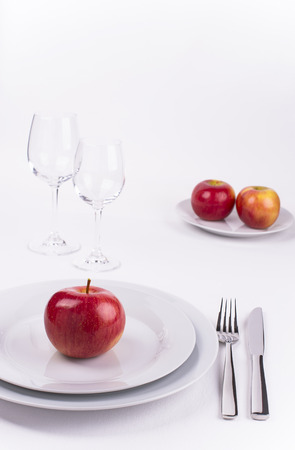 Table set with apples on white background for menu and invitation