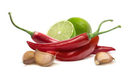 Red hot chilie pepper, garlic cloves, lime ingredients isolated on white background as package design element