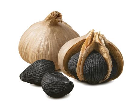 Foto für Black garlic bulbs and cloves isolated on white - Lizenzfreies Bild