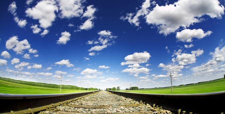 summe landscape with railroad and cloudy sky
