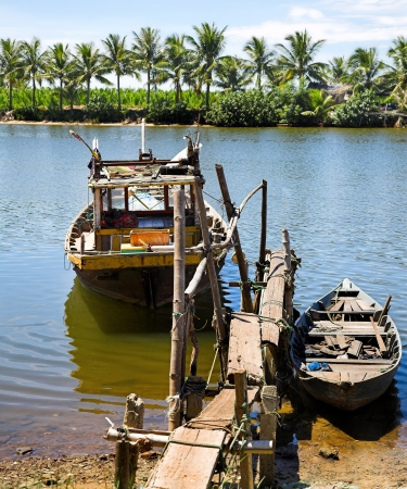 two fishers boats on the tropical river