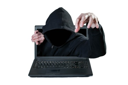 Scary man without face reaching out from the computer, danger from network