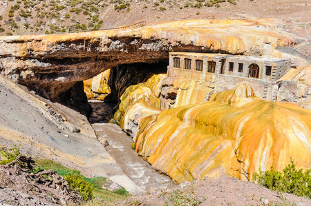 View of the golden arch of the Puente del Inca in The Andes around Mendoza, Argentina.