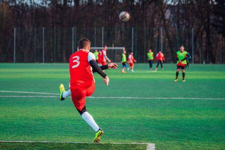 Foto de Soccer photo, player kick the ball, football professional match - Imagen libre de derechos