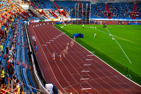 Photo for OSTRAVA, CZECH REPUBLIC, SEPTEMBER. 8. 2020: Hurdles professional track and field athletics race. Female athletes on stadium. - Royalty Free Image