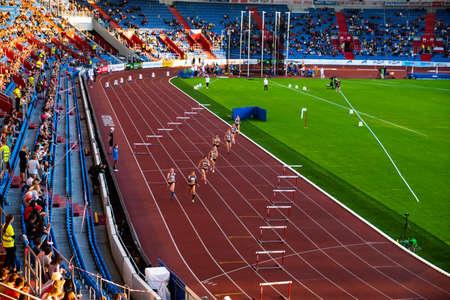 Foto für OSTRAVA, CZECH REPUBLIC, SEPTEMBER. 8. 2020: Hurdles professional track and field athletics race. Female athletes on stadium. - Lizenzfreies Bild