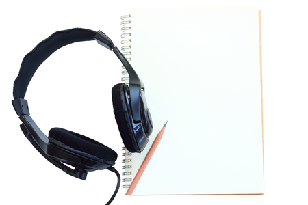 Earphone  and notebook for writer listener on white background.