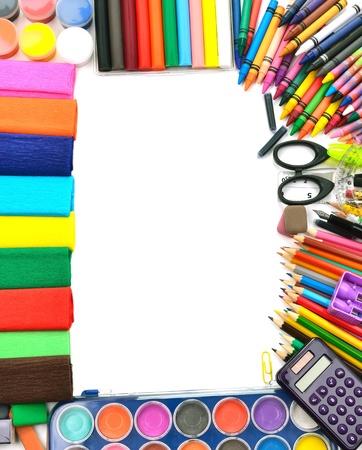 Foto de School and office supplies frame, on white background, back to school - Imagen libre de derechos