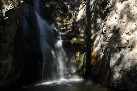 Rainbow at the waterfall Millomeris, in the mountains in Cyprus