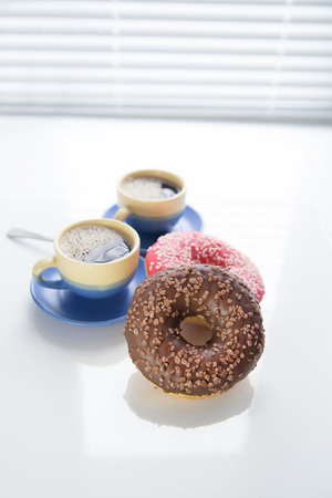 hot coffee and donut in morning. Soft vintage colors