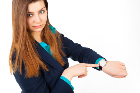 angry business woman pointing her watch over white background