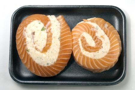 Salmon pinwheels with crabmeat on styrofoam tray