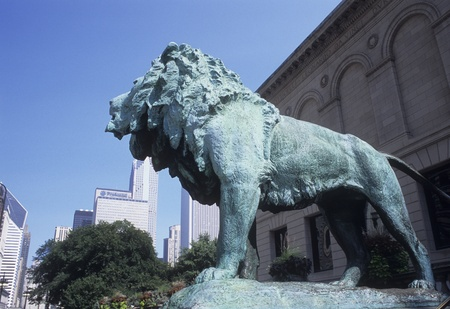 Front of the Chicago Art Institute with bronze lion sculpture facing Michigan Avenue.