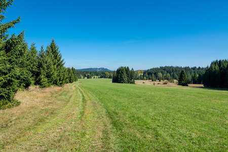 Mountain landscape with blue sky. Summery hiking in Novohradske mountains, Czech Republic, Europe.