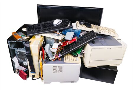 Photo pour Pile of discarded computer parts isolated on white background. Used hardware components as keyboards, printers or PC cases. Eco separation, recycling and disposal of electronic metal or plastic waste. - image libre de droit
