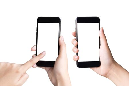 Photo for two hands holding and playing smart phones on white background - Royalty Free Image