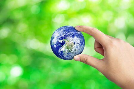 Photo pour Hand Holding Earth On Green Bokeh Nature Blur Background, Save The World Concept - image libre de droit